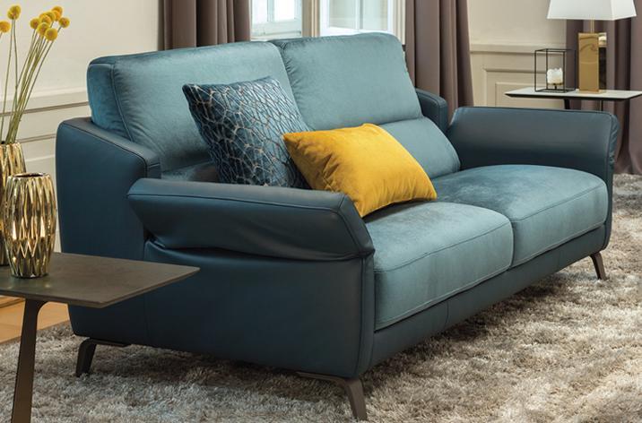 Sofa Diva w niebieskim obiciu - tkaninie oraz skórze - z oferty firmy Kler